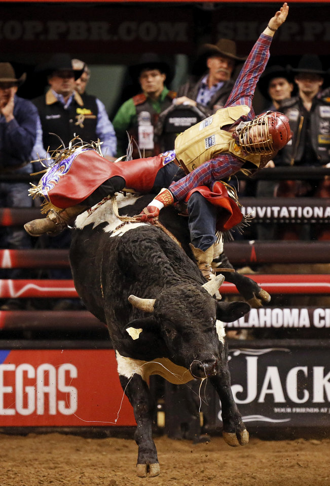 Cody Nance rides Kracker Smacker to an 83.5  during the WinStar World Casino Invitational PBR bull riding event at Chesapeake Energy Arena in Oklahoma City, Friday, Jan. 25, 2013. Photo by Nate Billings, The Oklahoman
