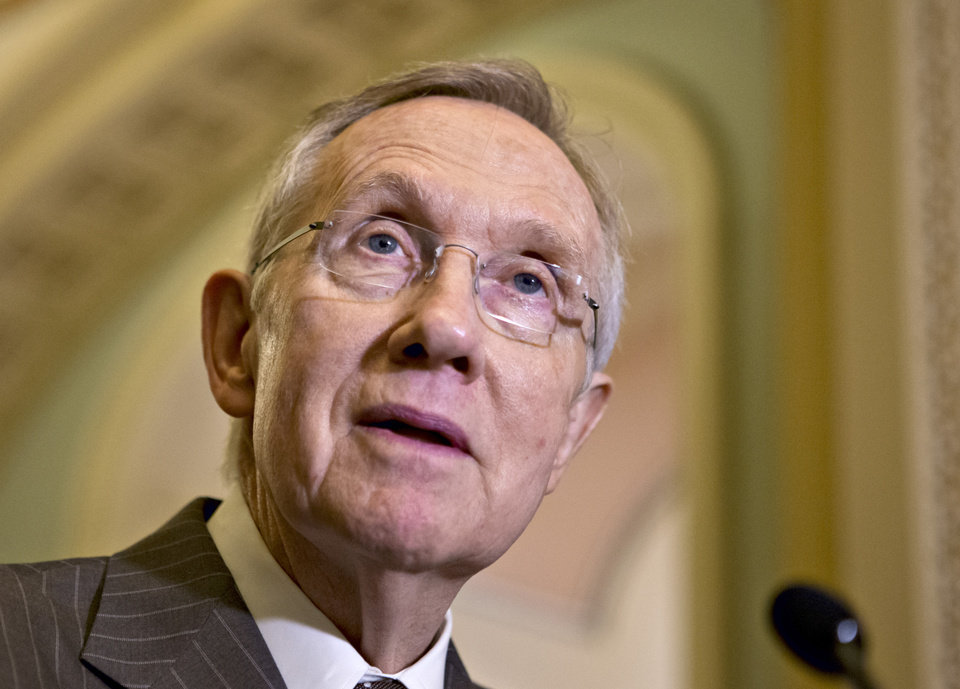 Senate Majority Leader Harry Reid, D-Nev., speaks with reporters following a Democratic strategy session at the Capitol in Washington, Tuesday, Dec. 11, 2012.   (AP Photo/J. Scott Applewhite)