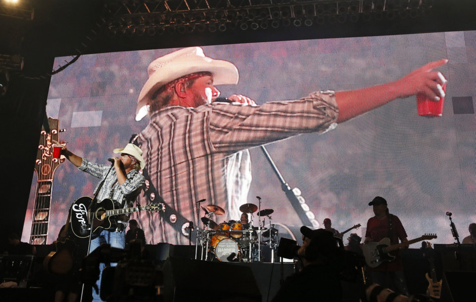 Photo - OKLAHOMA COUNTRY SINGER / SONGWRITER / MUSICIAN / PERFORMER / BENEFIT CONCERT / TORNADO AID: Toby Keith performs during the Oklahoma Twister Relief Concert, benefiting victims of the May tornadoes, at Gaylord Family - Oklahoma Memorial Stadium on the campus of the University of Oklahoma in Norman, Okla., Saturday, July 6, 2013. Photo by Nate Billings, The Oklahoman