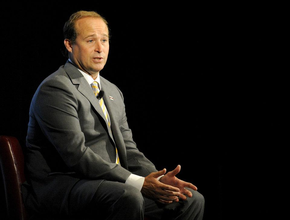 West Virginia head coach Dana Holgorsen speaks at NCAA college football Big 12 Media Days, Tuesday, July 24, 2012, in Dallas. (AP Photo/Matt Strasen)