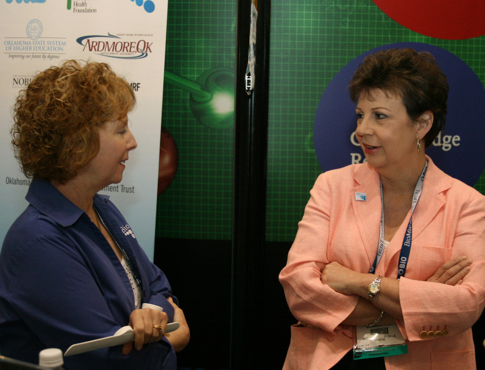 Photo - Sheryl Hale, Oklahoma Department of Career and Technology Education in Stillwater, and Sheri Stickley, president of the OKBio Association, Wednesday at the BIO International convention in Boston. PHOTO BY JIM STAFFORD  unknown