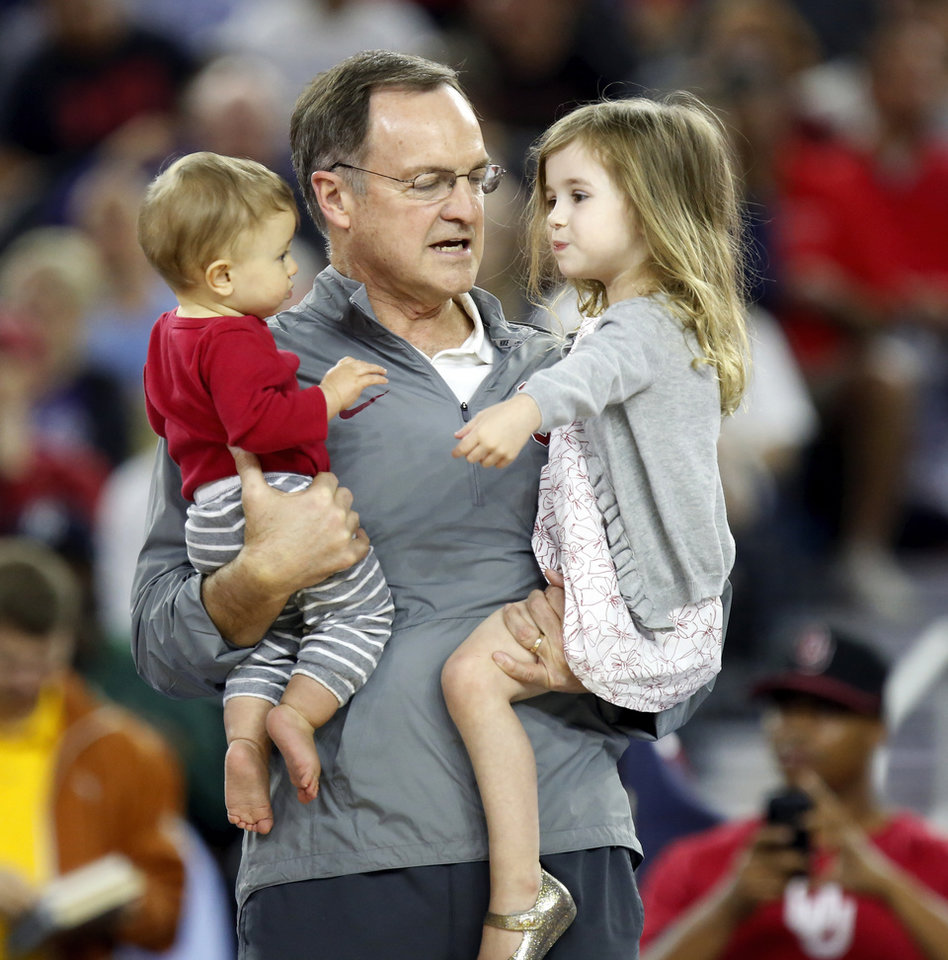 Photo - Oklahoma coach Lon Kruger holds grandchildren Wyatt Ciklin, left, and Avery Ciklin during practice on Final Four Friday before the national semifinal between the Oklahoma Sooners and the Villanova Wildcats in the NCAA Men's Basketball Championship at NRG Stadium in Houston, Friday, April 1, 2016. OU will play Villanova in the Final Four on Saturday. Photo by Nate Billings, The Oklahoman
