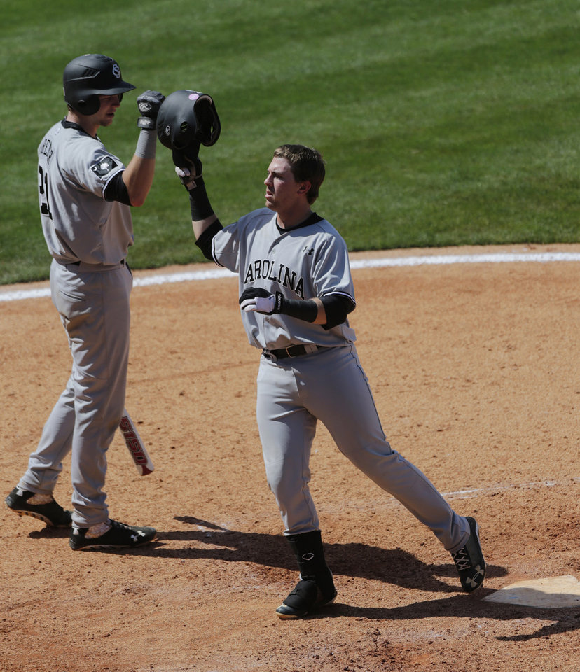 Photo - South Carolina's LB Dantzler, right, reacts with teammate Grayson Greiner after hitting a solo home run off Vanderbilt's Carson Fulmer in the seventh inning of their Southeastern Conference Tournament college baseball game at the Hoover Met in Hoover, Ala., Thursday, May 23, 2013. (AP Photo/Dave Martin)