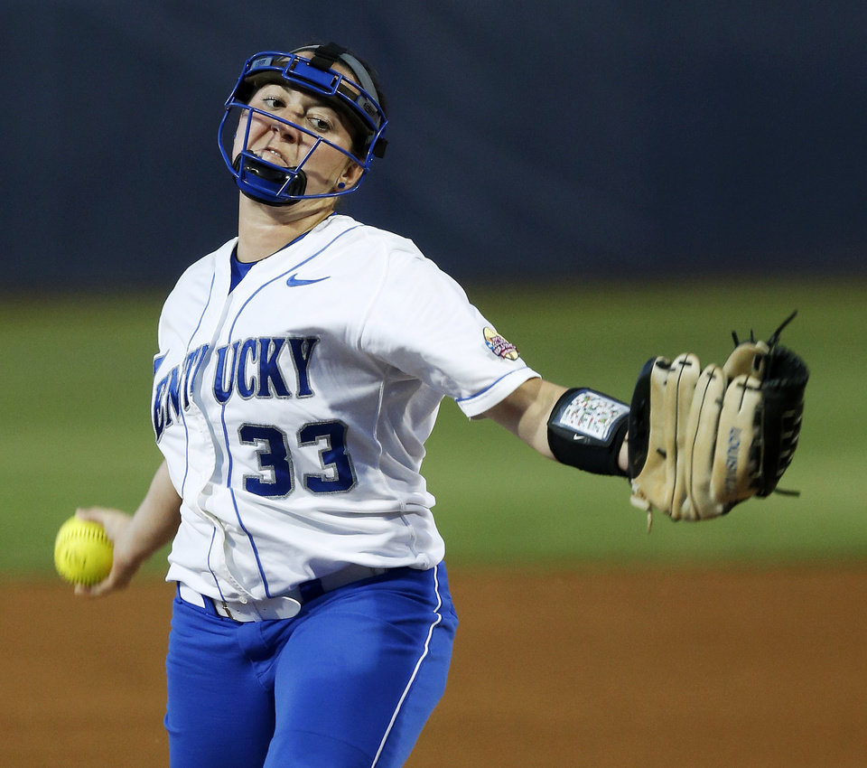 Photo - Kentucky's Kelsey Nunley (33) pitches during Game 6 of the Women's College World Series softball tournament between Alabama and Kentucky at ASA Hall of Fame Stadium in Oklahoma City, Friday, May 30, 2014. Alabama won, 2-0. Photo by Nate Billings, The Oklahoman