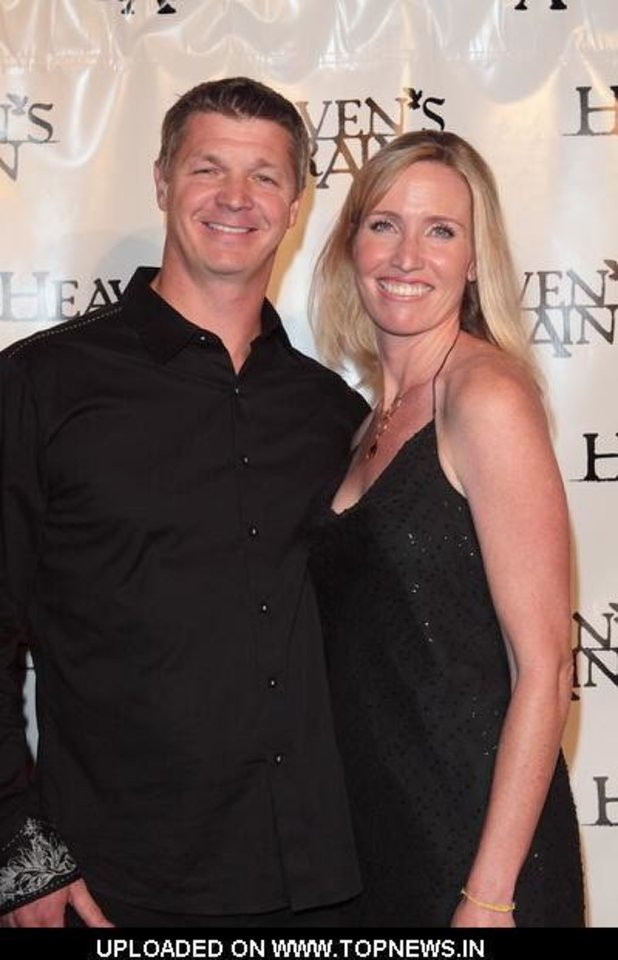 Brooks Douglass and his wife, Julea, pose for a picture at a premiere event for the feature film