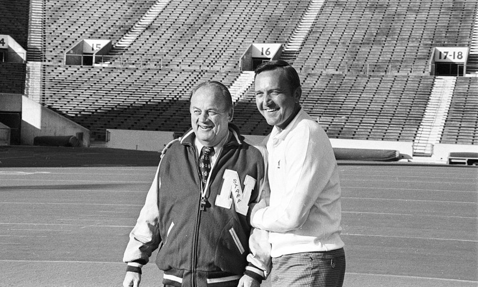 Photo - Chuck Fairbanks, right, University of Oklahoma head football coach, welcomes Nebraska head coach Bob Devaney to Norman, Okla., on Nov. 24, 1971.  Their college teams will play Thanksgiving Day.  (AP Photo)