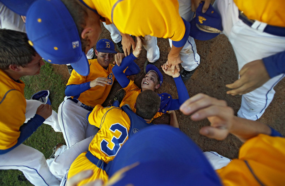 Bethel pitcher Jason Swafford is at the bottom of the team dogpile as he celebrates the win over Eufaula in the Class 3A State Baseball Championships between Eufaula and Bethel at Shawnee High School on Monday, May 17, 2010, in Shawnee, Okla. Photo by Chris Landsberger, The Oklahoman