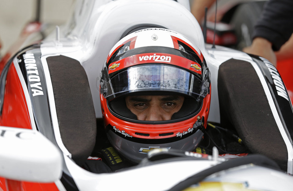 Photo - Former Indy 500 champion Juan Pablo Montoya, of Colombia, sits in his car during testing for the inaugural Grand Prix of Indianapolis auto race on the new road course at the Indianapolis Motor Speedway in Indianapolis, Wednesday, April 30, 2014. (AP Photo/Michael Conroy)