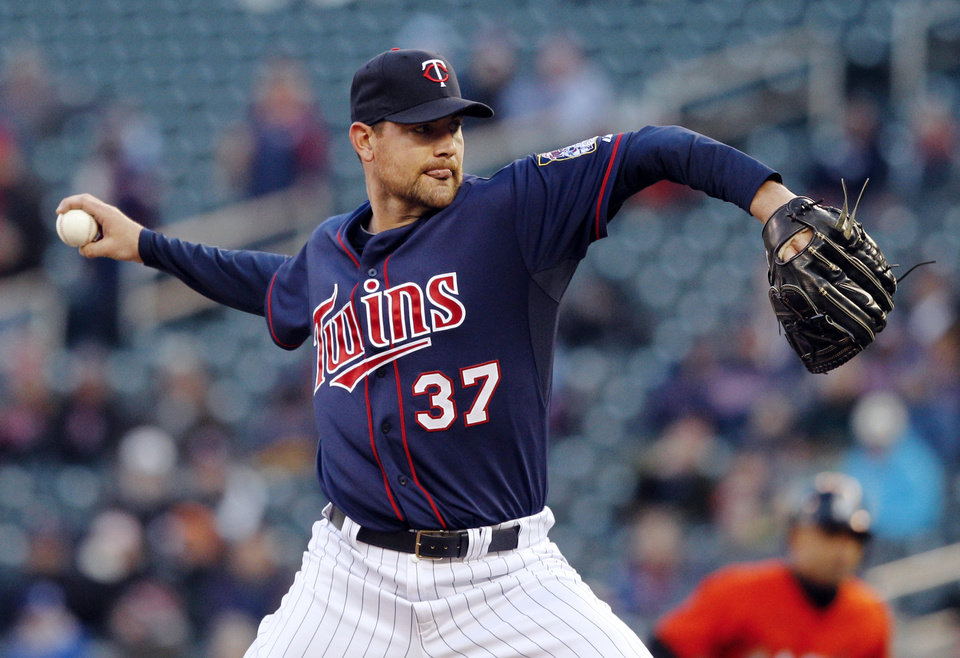 Photo - Minnesota Twins starting pitcher Mike Pelfrey (37) throws against the Miami Marlins during the first inning in the second baseball game of a doubleheader Tuesday, April 23, 2013, in Minneapolis. (AP Photo/Genevieve Ross)