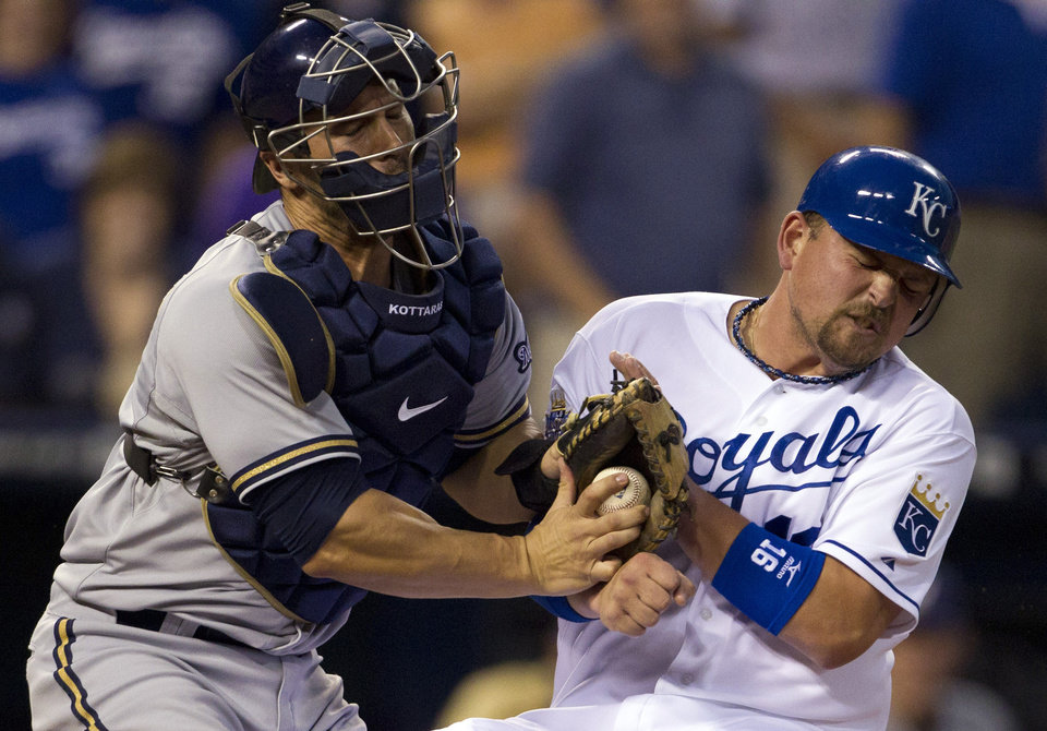 Photo -   Milwaukee Brewers catcher George Kottaras, left, tags out Kansas City Royals' Billy Butler (16) during the sixth inning of a baseball game at Kauffman Stadium in Kansas City, Mo., Wednesday, June 13, 2012. Butler was trying to score from second base on a single by teammate Jeff Francoeur. (AP Photo/Orlin Wagner)