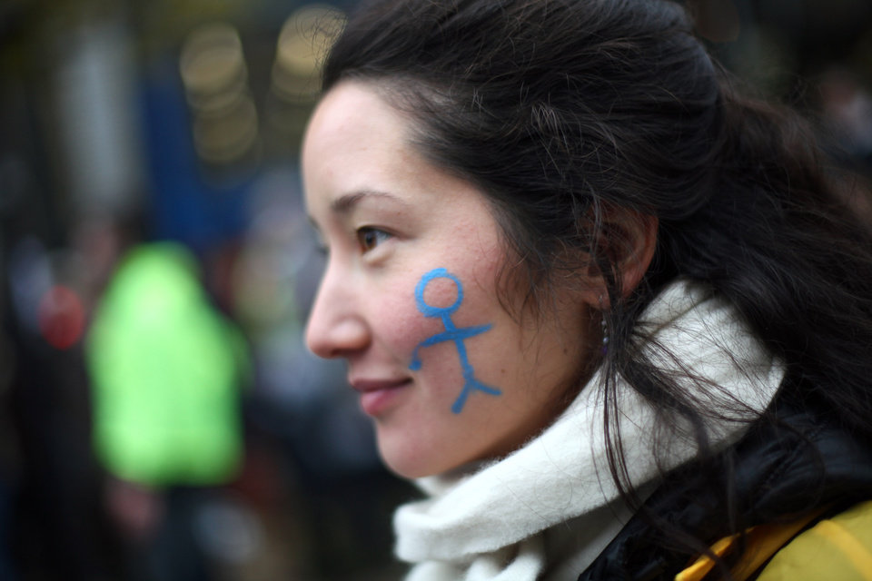 Photo -   A demonstrator protests against French President Francois Hollande's plan to legalize marriage and adoption for gay people, in Paris, Saturday Nov. 17, 2012. Saturday's event, entitled