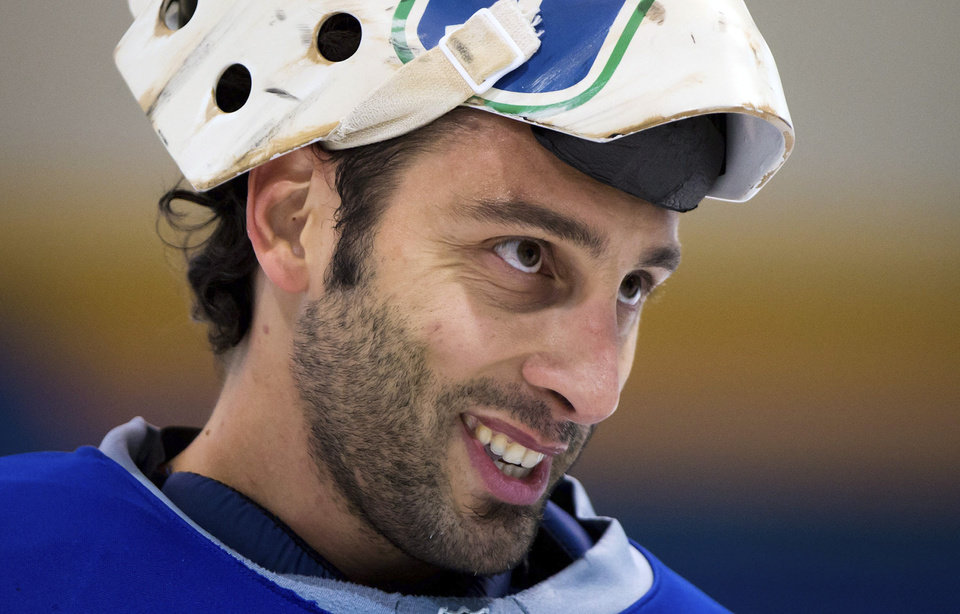 Vancouver Canucks goalie Roberto Luongo smiles during an informal hockey practice with his teammates at the University of British Columbia in Vancouver, British Columbia, on Friday, Jan. 11, 2013. (AP Photo/The Canadian Press, Darryl Dyck)