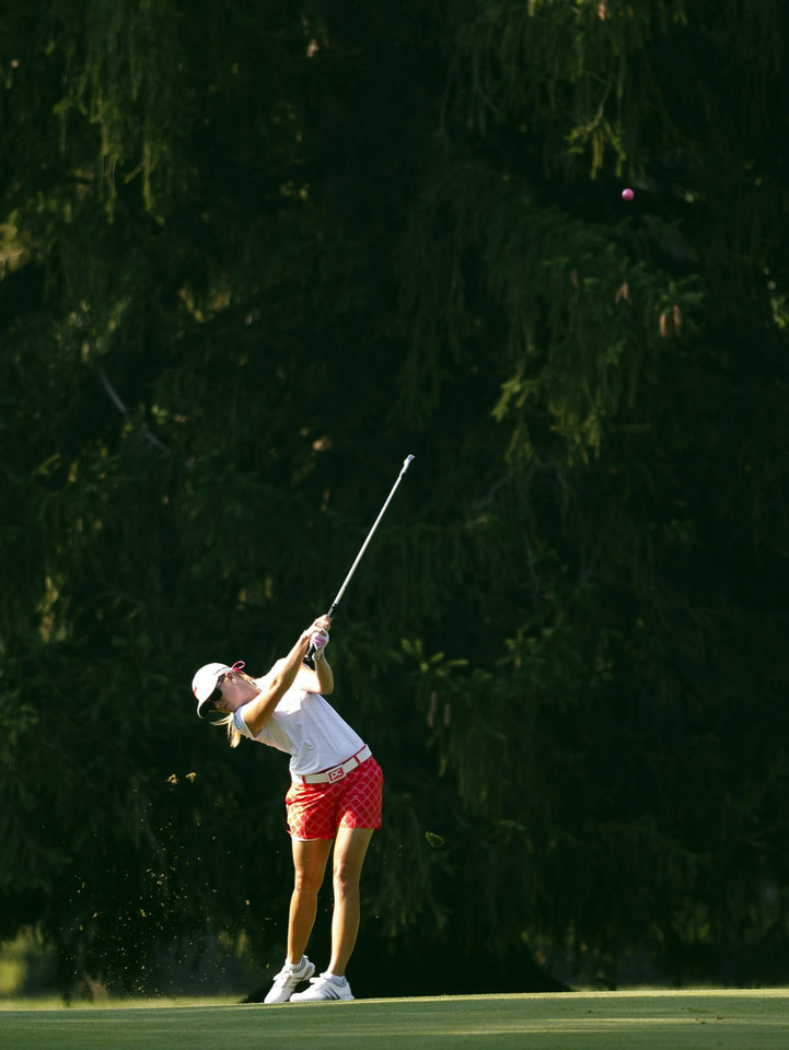 Photo - Paula Creamer hits her approach shot on the fourth hole during the second round of the Marathon Classic golf tournament at Highland Meadows Golf Club in Sylvania, Ohio, Friday, July 19, 2013. (AP Photo/Rick Osentoski)