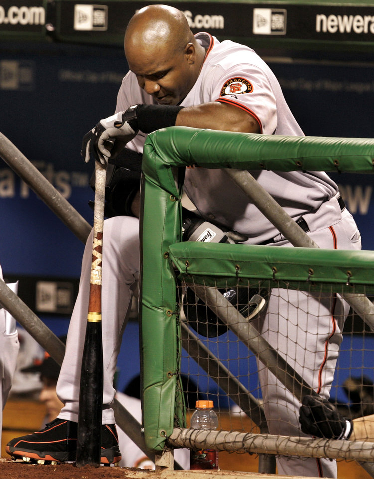Photo - FILE - In this July 28, 2006, file photo, San Francisco Giants' Barry Bonds waits on the dugout steps to bat in the eighth inning with bases loaded against the Pittsburgh Pirates during a baseball game in Pittsburgh. With the cloud of steroids shrouding many candidacies, baseball writers may fail for the only the second time in more than four decades to elect anyone to the Hall. (AP Photo/Gene J. Puskar, File)