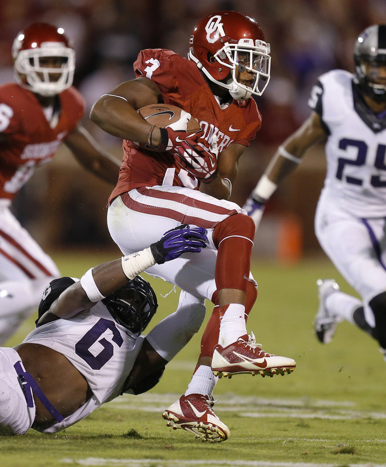Photo - Oklahoma's Sterling Shepard (3) tries to get away from TCU's Elisha Olabode (6) during a college football game between the University of Oklahoma Sooners (OU) and the TCU Horned Frogs at Gaylord Family-Oklahoma Memorial Stadium in Norman, Okla., on Saturday, Oct. 5, 2013. Oklahoma won 20-17. Photo by Bryan Terry, The Oklahoman