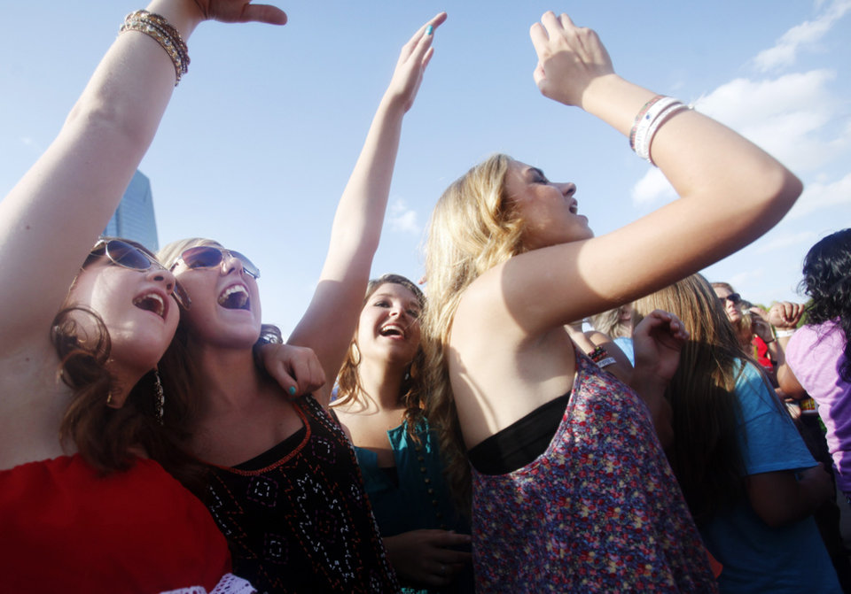 Photo - Music fans sing along as Casey Donahew Band performs at OKC Fest in downtown Oklahoma City on Friday, June 27, 2014. OKC Fest is a new two day country music festival with multiple stages downtown. Photos by KT King/The Oklahoman