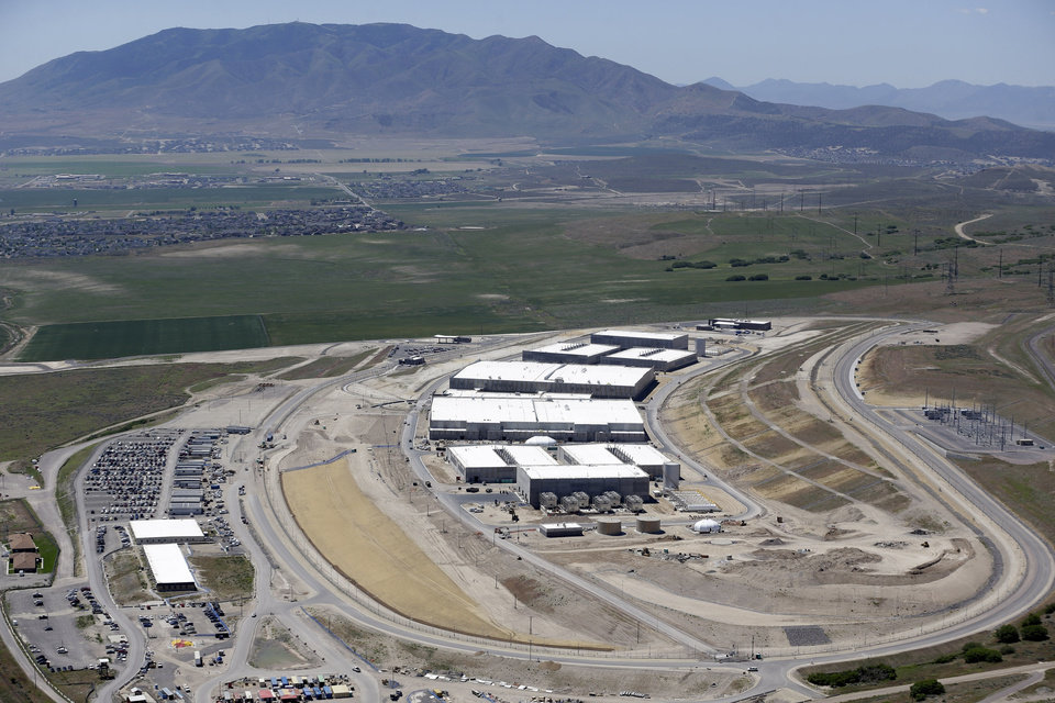This June 6, 2013 photo, shows an aerial view of the NSA's Utah Data Center in Bluffdale, Utah. The nation's new billion-dollar epicenter for fighting global cyberthreats sits just south of Salt Lake City, tucked away on a National Guard base at the foot of snow-capped mountains. The long, squat buildings span 1.5 million square feet, and are filled with super-powered computers designed to store massive amounts of information gathered secretly from phone calls and emails. (AP Photo/Rick Bowmer)