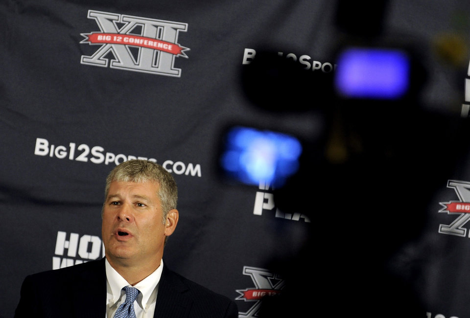 Photo - Iowa State head coach Paul Rhoads answers questions during NCAA college football Big 12 Media Days, Tuesday, July 26, 2011, in Dallas. (AP Photo/Matt Strasen)