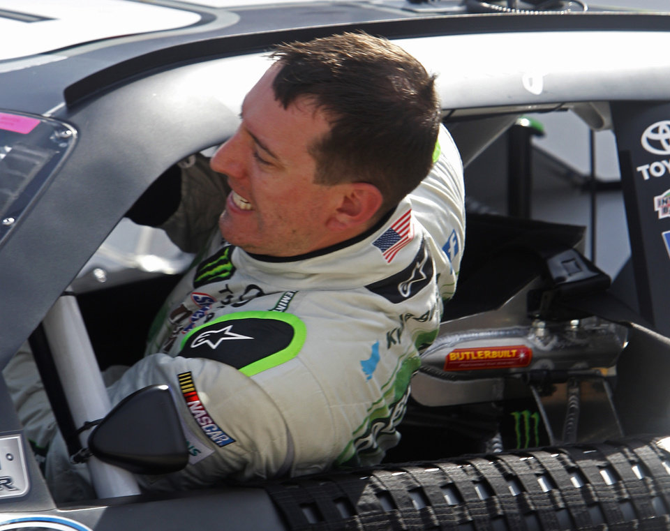 Photo - Kyle Busch climbs from his car after qualifying for the Food City 300 NASCAR Nationwide Series auto race at Bristol Motor Speedway on Friday, Aug. 22, 2014, in Bristol, Tenn. Busch will start on the pole. (AP Photo/Wade Payne)