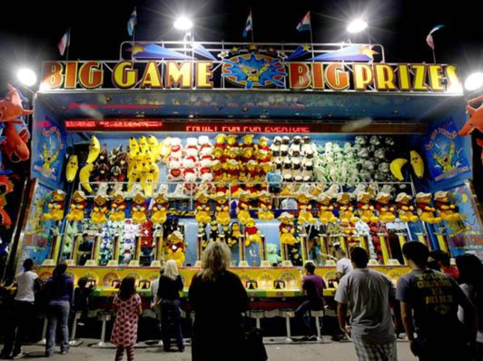 Fairgoers stand in front of a game at the Oklahoma State Fair in Oklahoma City on Friday, September 18, 2009. Photo by Bryan Terry, The Oklahoman