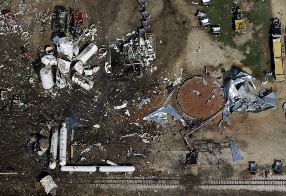 Photo - FILE - This April 18, 2013, file aerial photo shows the remains of the West Fertilizer Co. plant destroyed by an explosion in West, Texas. The Texas company that operated the fertilizer plant where a thunderous explosion in April killed 15 people is facing $118,300 in fines for two dozen serious safety violations, including a failure to have an emergency response plan, federal officials said Thursday, Oct. 10, 2013. (AP Photo/Tony Gutierrez, File)