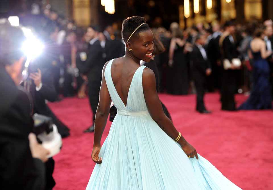 Photo - Lupita Nyong'o arrives at the Oscars on Sunday, March 2, 2014, at the Dolby Theatre in Los Angeles.  (Photo by Chris Pizzello/Invision/AP)