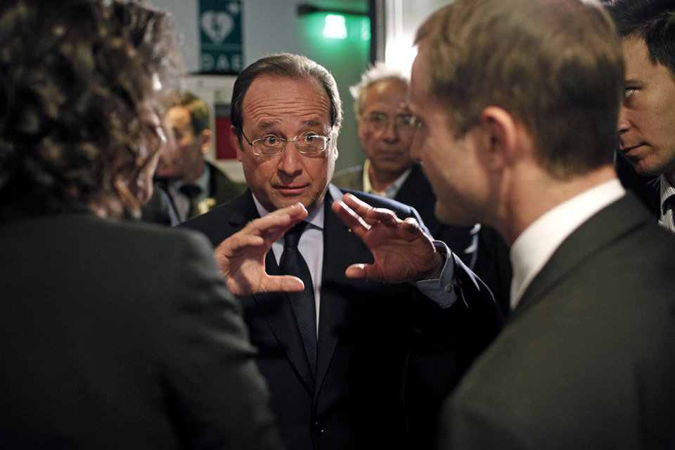 Photo - France's President Francois Hollande, center, gestures as he talks to the media after an interview with BFM television journalist in Paris, Tuesday, May 6, 2014. Hollande celebrates Tuesday his second anniversary in charge. (AP Photo/Thibault Camus, Pool)