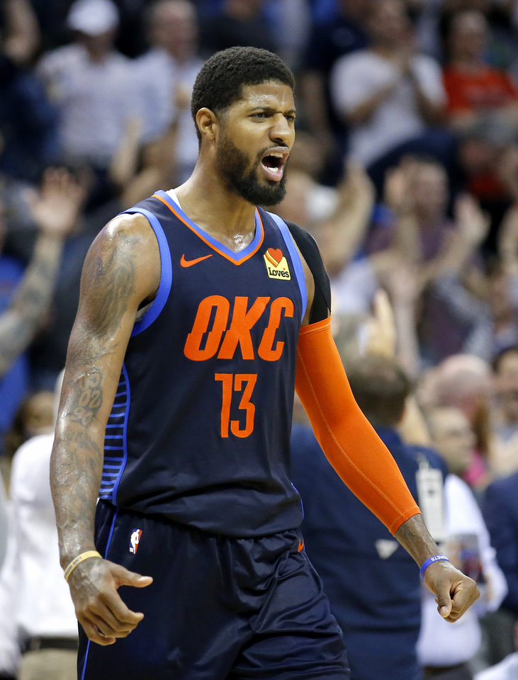 Photo - Oklahoma City's Paul George (13) celebrates his game winning 3-point basket in the final seconds of the fourth quarter during the NBA basketball game between the Oklahoma City Thunder and Houston Rockets at the Chesapeake Energy Arena, Tuesday, April 9, 2019. Cowboys won 6-5. Photo by Sarah Phipps, The Oklahoman