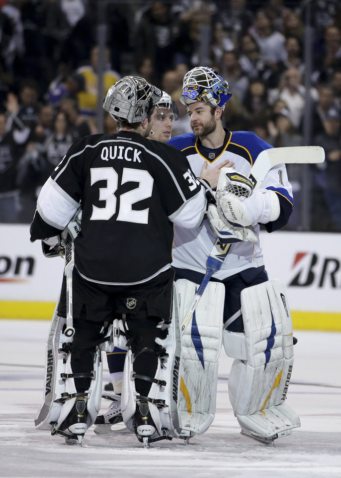 Photo - Los Angeles Kings goalie Jonathan Quick, left, is congratulated by St. Louis Blues goalie Brian Elliott after Game 6 of a first-round NHL hockey Stanley Cup playoff series in Los Angeles, Friday, May 10, 2013. The Kings won 2-1. (AP Photo/Jae C. Hong)