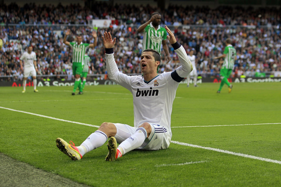 Real Madrid\'s Cristiano Ronaldo from Portugal gestures during a Spanish La Liga soccer match against Betis at the Santiago Bernabeu stadium in Madrid, Spain, Saturday, April 20, 2013. (AP Photo/Andres Kudacki)