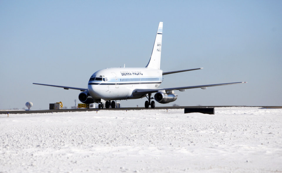Photo - A Sierra Pacific flight taxies down the runway Dec. 28 at Will Rogers World Airport in Oklahoma City.   Photo by Steve Gooch, The Oklahoman
