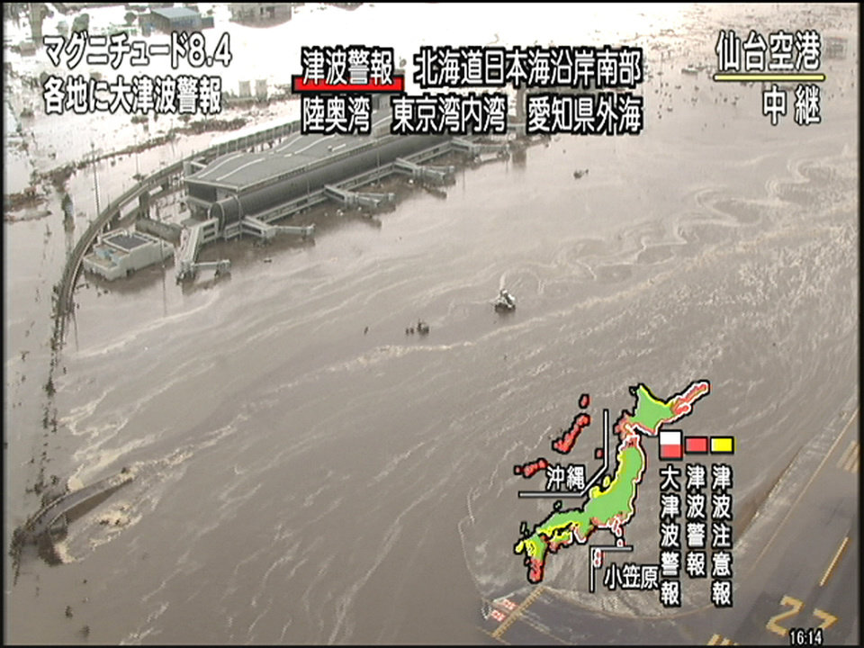 Photo - In this image taken from NHK television, Sendai Airport is flooded after an strong earthquake in Sendai, northern Japan Friday, March 11, 2011. (AP Photo/NHK) JAPAN OUT, TV OUT, NO SALES, ONLINE OUT, EDITORIAL USE ONLY ORG XMIT: TOK806