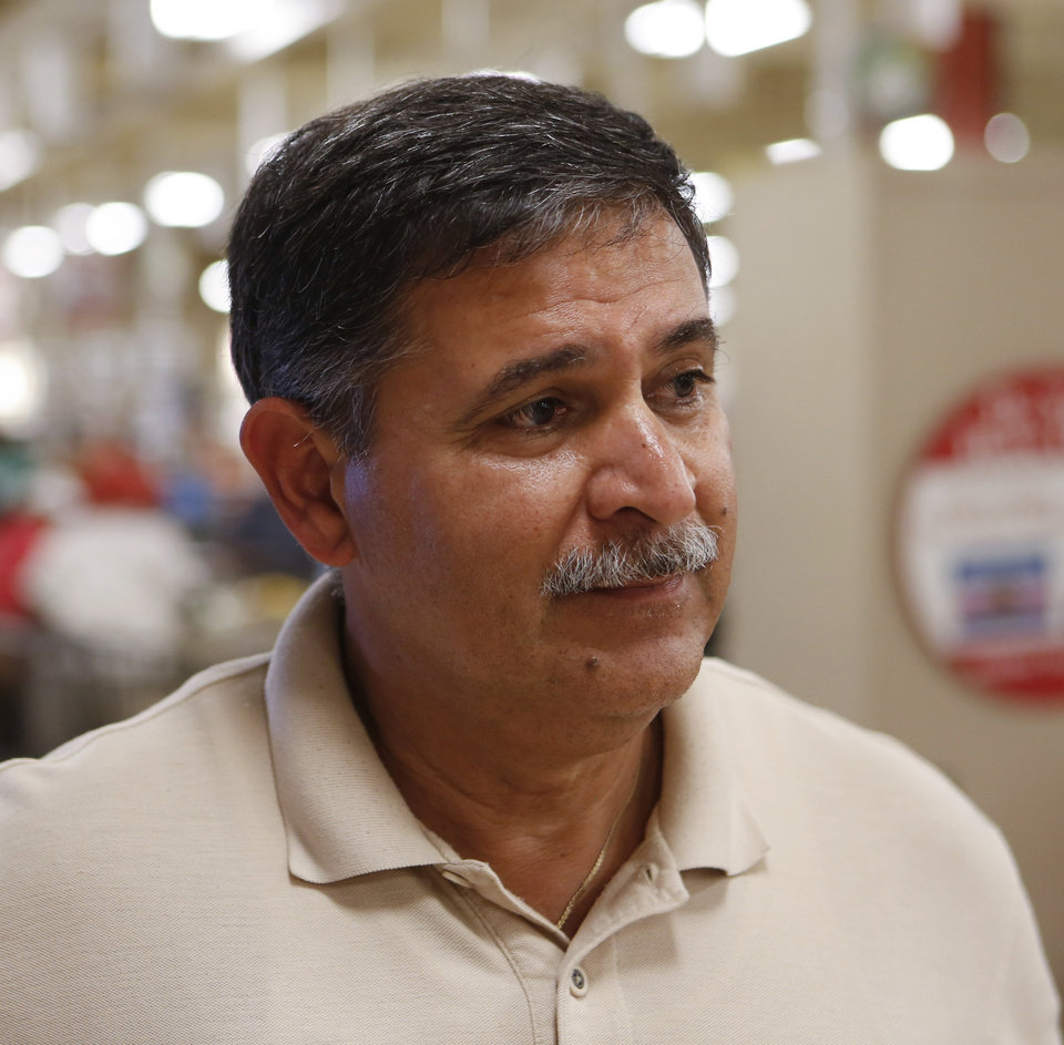 Photo -  Manuel Othon, assistant director of the Commissary, said his dad was in the military, and he's been around it his whole life. He has worked for the Commissary for 30-40 years, though he hasn't been at Tinker the whole time. [Photo by Jacob Derichsweiler, The Oklahoman]