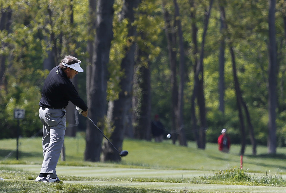 Photo - Joey Sindelar hits his tee shot on the 10th hole in the first round of the 75th Senior PGA Championship golf tournament at the Harbor Shores Golf Club during a news conference in Benton Harbor, Mich., Thursday, May 22, 2014.  (AP Photo/Paul Sancya)