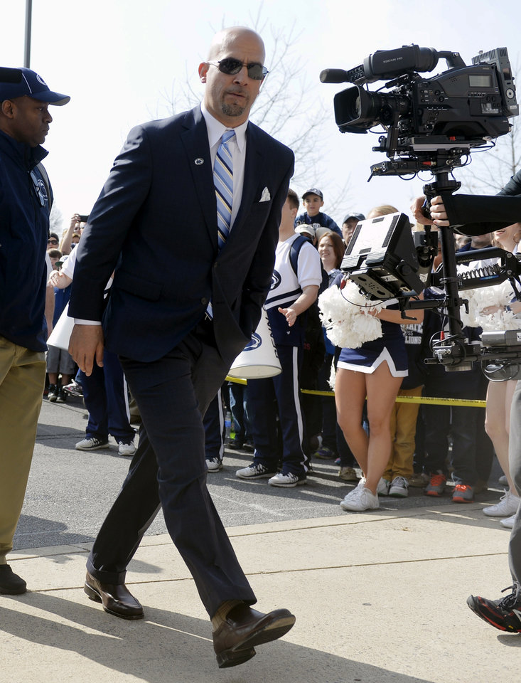 Photo - New Penn State head football coach James Franklin walks toward Beaver Stadium after letting the team enter first before the Blue-White game on Saturday, April 12, 2014 in State College, Pa. The 2014 Blue-White game, Penn State's spring football scrimmage, will be new head coach James Franklin's first game in Beaver Stadium. (AP Photo/York Daily Record, Chris Dunn)  YORK DISPATCH OUT