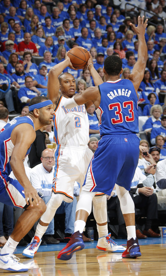 Photo - Caron Butler (2) looks to pass against Danny Granger (33) during Game 2 of the Western Conference semifinals in the NBA playoffs between the Oklahoma City Thunder and the Los Angeles Clippers at Chesapeake Energy Arena in Oklahoma City, Wednesday, May 7, 2014. Photo by Bryan Terry, The Oklahoman