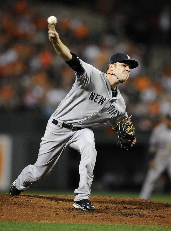 Photo -   New York Yankees starter David Phelps delivers a pitch to a Baltimore Orioles batter during the second inning of a baseball game, Thursday, Sept. 6, 2012, in Baltimore. (AP Photo/Nick Wass)