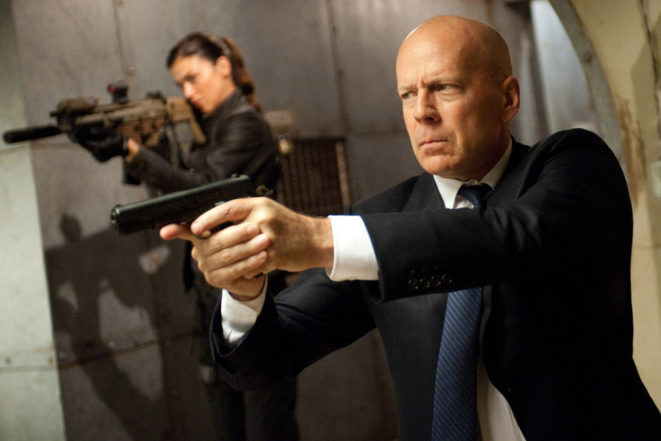Adrianne Palicki, left, and Bruce Willis in a scene from �G.I. Joe: Retaliation.� PARAMOUNT PICTURES PHOTO