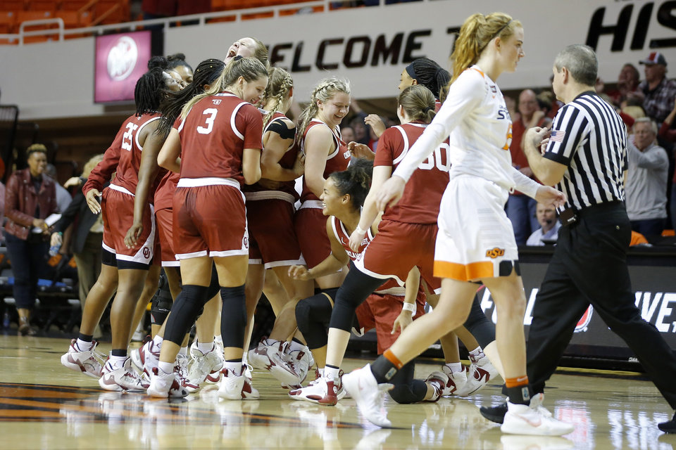 Photo - Oklahoma celebrates behind Oklahoma State's Vivian Gray (12) after winning a women's Bedlam college basketball game between the Oklahoma State University Cowgirls (OSU) and the University of Oklahoma Sooners (OU) at Gallagher-Iba Arena in Stillwater, Okla., Wednesday, Jan. 8, 2020. [Bryan Terry/The Oklahoman]