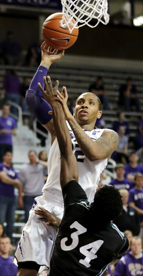 Kansas State guard Rodney McGruder (22) shoots over South Carolina Upstate\'s Babatunde Olumuyiwa (34) during the second half of an NCAA college basketball game, Sunday, Dec. 2, 2012, in Manhattan, Kan. Kansas State won 72-53. (AP Photo/Charlie Riedel)