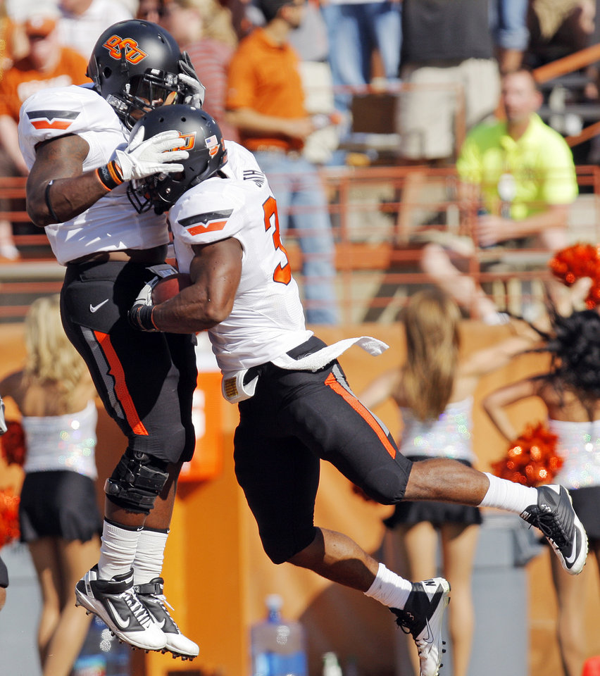 Photo - Oklahoma State's Kye Staley (9), left, celebrates with Jeremy Smith (31) a touchdown run by Smith in the second quarter during a college football game between the Oklahoma State University Cowboys (OSU) and the University of Texas Longhorns (UT) at Darrell K Royal-Texas Memorial Stadium in Austin, Texas, Saturday, Oct. 15, 2011. Photo by Nate Billings, The Oklahoman