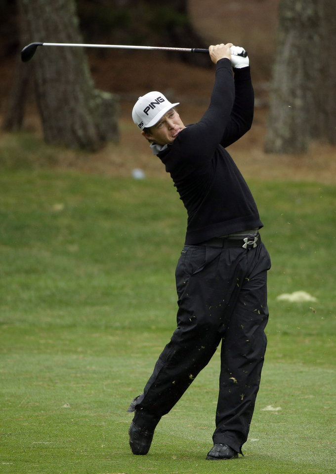 Photo - Daniel Summerhays hits from the 16th fairway Saturday, Feb. 8, 2014, during the third round of the AT&T Pebble Beach Pro-Am golf tournament on the Spyglass Hill Golf Course in Pebble Beach, Calif. (AP Photo/Ben Margot)