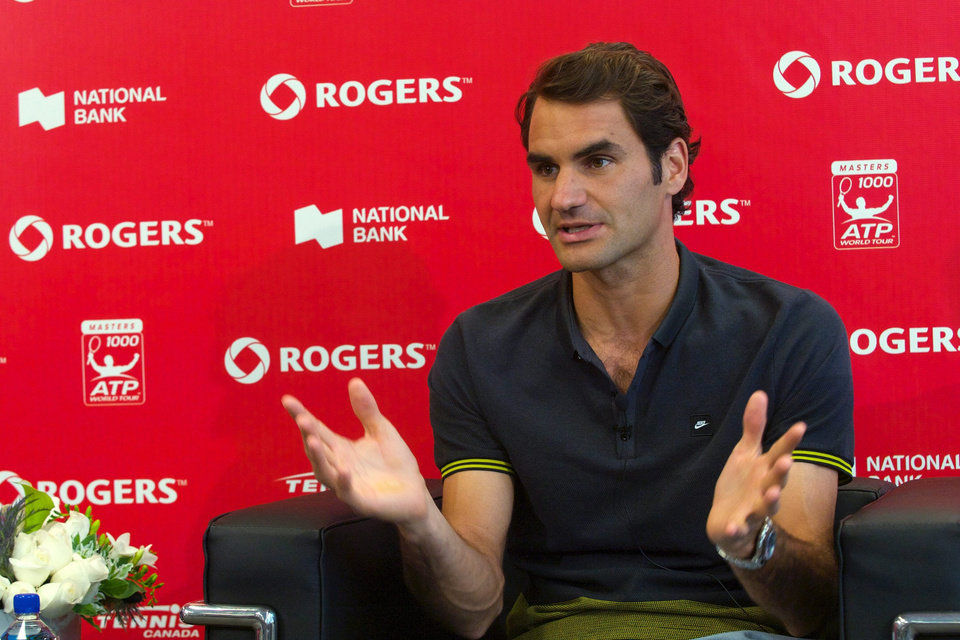 Photo - Roger Federer, of Switzerland, gestures during a news conference at the Rogers Cup tennis tournament in Toronto on Sunday, Aug. 3, 2014. (AP Photo/The Canadian Press, Victor Biro)