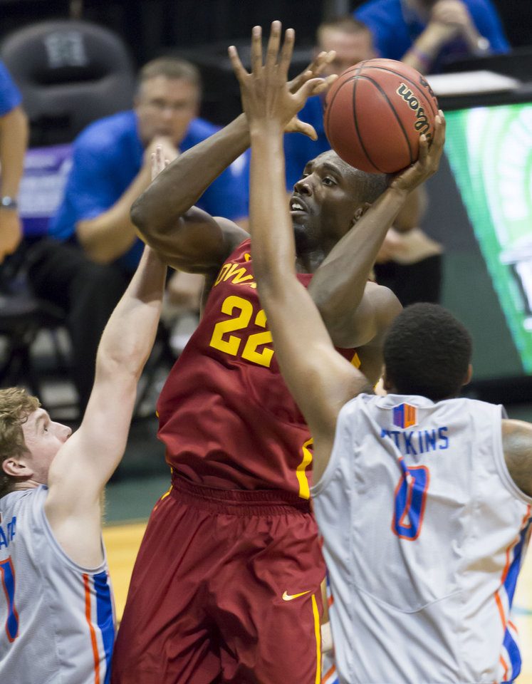 Photo - Iowa State forward Dustin Hogue (22) shoots between Boise State guard Jeff Elorriaga, left, and forward Ryan Watkins (0) during the first half of an NCAA college basketball game at the Diamond Head Classic on Wednesday, Dec. 25, 2013, in Honolulu. (AP Photo/Eugene Tanner)