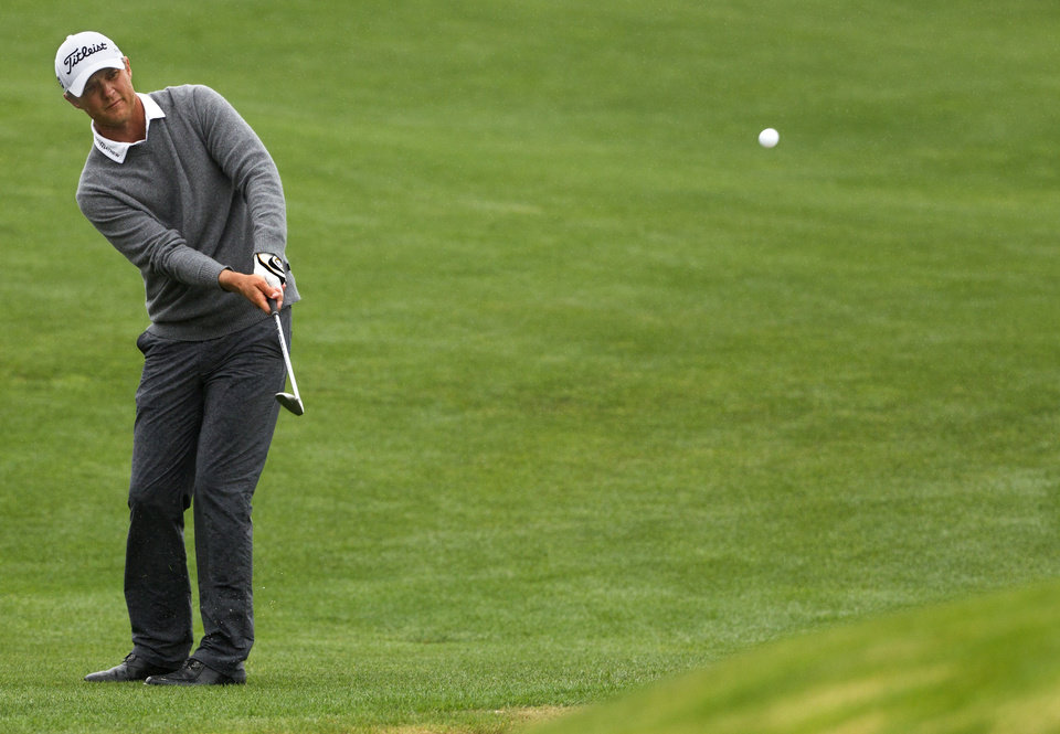 Photo - Matt Jones chips in for birdie on a playoff hole against Matt Kuchar to win the Houston Open golf tournament on Sunday, April 6, 2014, in Humble, Texas. (AP Photo/Patric Schneider)