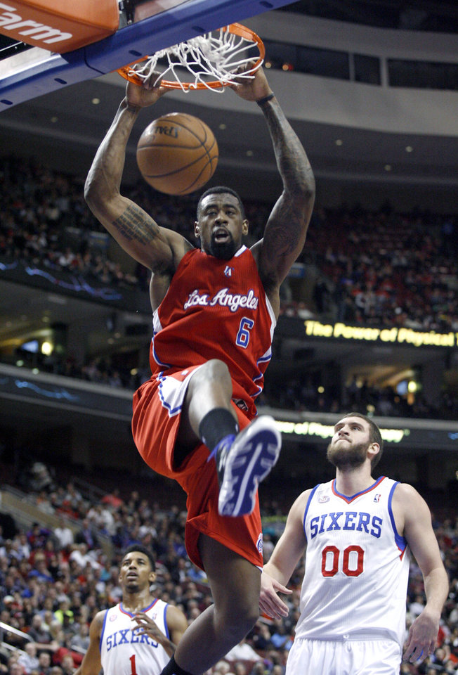 Los Angeles Clippers' DeAndre Jordan (6) scores as Philadelphia 76ers' Spencer Hawes (00) watches in the first half of an NBA basketball game, Monday, Feb. 11, 2013, in Philadelphia. (AP Photo/H. Rumph Jr)