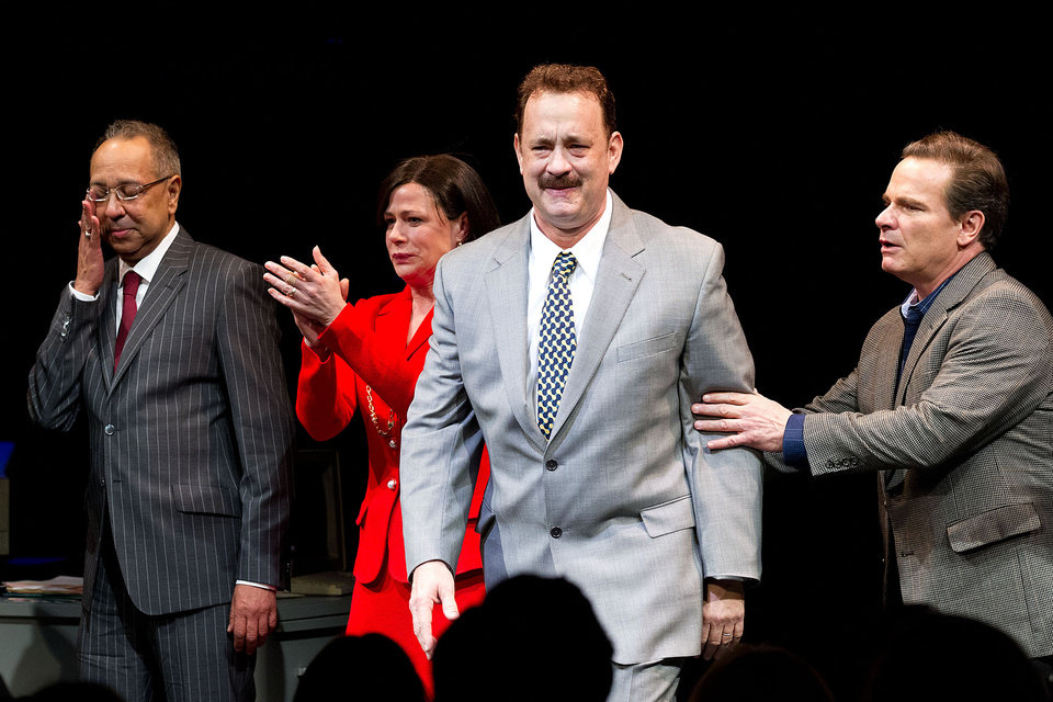 Photo - This April 1, 2013 file photo shows, from left, George C. Wolfe, Maura Tierney, Tom Hanks and Peter Scolari at the Lucky Guy Opening Night, in New York. Hanks received a Tony nomination for best leading actor in a play, Tuesday, April 30, for his role in