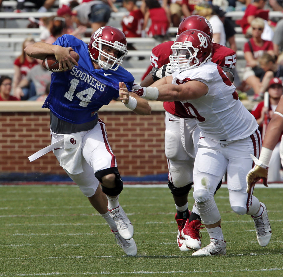 Photo - Cody Thomas is tagged down by Matt Dimon during the Spring College Football Game of the University of Oklahoma Sooners (OU) at Gaylord Family-Oklahoma Memorial Stadium in Norman, Okla., on Saturday, April 12, 2014.  Photo by Steve Sisney, The Oklahoman