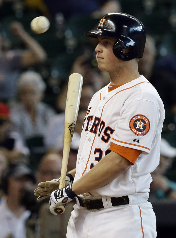 Photo - Houston Astros' Matt Dominguez stands still after striking out looking against the Seattle Mariners with a tying run on-base in the ninth inning of a baseball game on Saturday, May 3, 2014, in Houston. Seattle won 9-8. (AP Photo/Pat Sullivan)