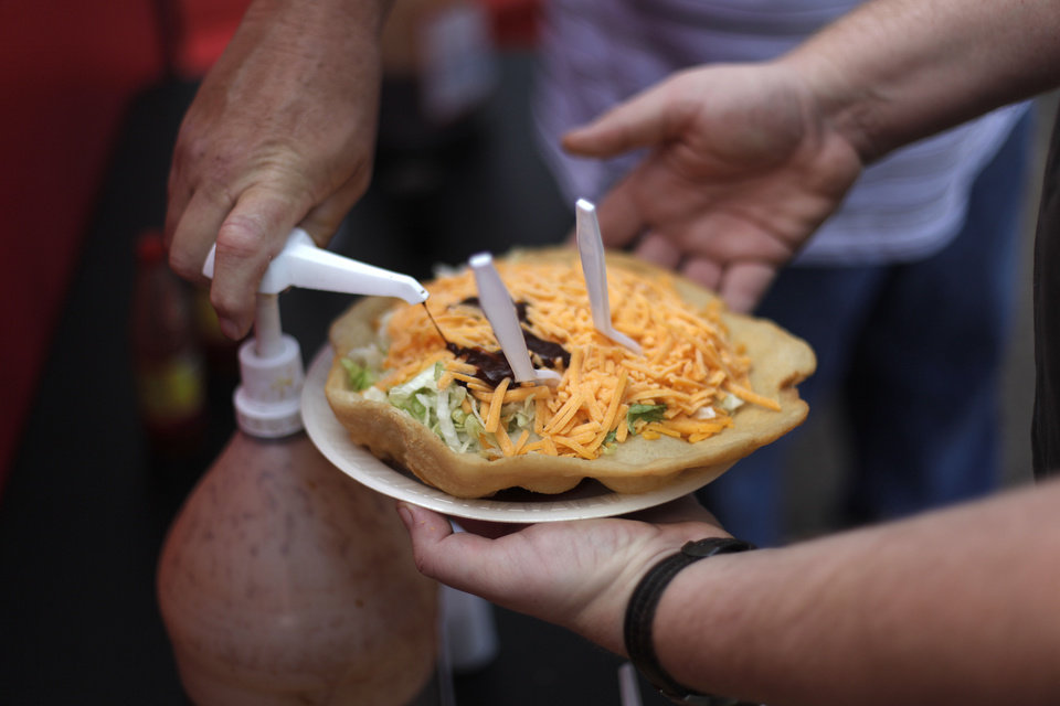 Photo - An indian taco at the Oklahoma State Fair, Sunday, Sept. 23, 2012.  Photo by Garett Fisbeck, The Oklahoman